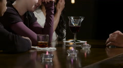 Sad, troubled young woman talking with friends at a bar - stock footage