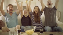 frenetic fans in front of tv - stock footage