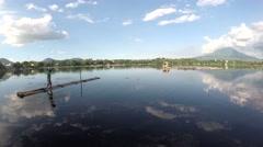 Lake boatman paddles his bamboo raft Stock Footage