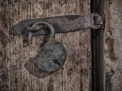 Grange lock on wooden door - stock photo