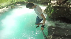 Canyoning adventure cliff jump selfie stick Stock Footage
