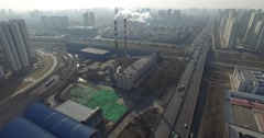 AERIAL FLY BY OF SMOKE STACK AT INDUSTRIAL CHINESE FACTORY - AIR POLLUTION - stock footage
