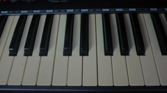 Male hands playing piano. Man Playing the synthesizer keyboard - stock footage