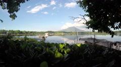 lake boatman paddles boat across the lake - stock footage