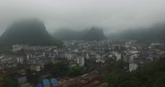 FLY THROUGH MOUNTAINS TO CITY IN GUILIN CHINA (1of2) Stock Footage