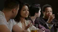 Young couples talking at a bar - stock footage