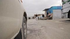 Iraqi Kurdistan IDP camp low angle shot while driving through the internal Stock Footage