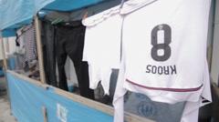 Iraqi Kurdistan IDP camp laundry drying and famous football player shirt Stock Footage