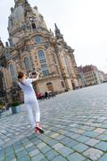 Young woman take photo Frauenkirche in Dresden Stock Photos