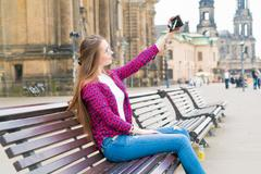 Woman tourist photographed retro camera historic part of the city, Dresden, G - stock photo