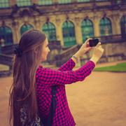 Young woman take photo Frauenkirche in Dresden - stock photo