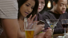 Group of people using cell phones at a bar Stock Footage