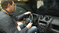 A man uses a simulator of driving of the car. Stock Footage