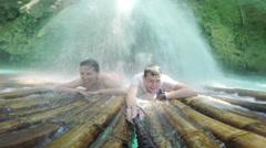 Canyoning adventure waterfall raft massage Stock Footage