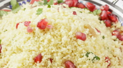 Couscous with pomegranate seeds, walnuts and parsley Stock Footage