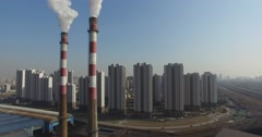 SMOKE STACK POLLUTION AT FACTORY NEAR APARTMENTS IN CHINA - stock footage