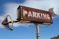 Vintage and Artsy Roadside Parking Sign - stock photo