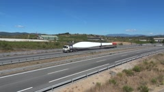 Truck carrying on a highway a wind turbine propeller Stock Footage