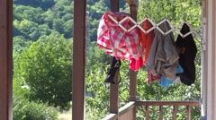 Laundry battered by the wind, which are allowed to dry on the balcony of the Stock Footage