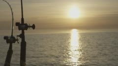 fishing rods sunset - stock footage
