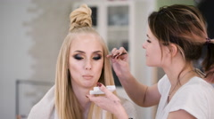 Professional Beauty judge and stylist at work. For a spectacular top models make Stock Footage