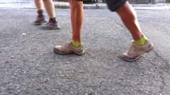 Tired legs pilgrims who walk on hot asphalt road from sunlight Stock Footage