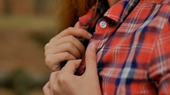 Sexy girl holding hands by the collar plaid shirt slow motion Stock Footage