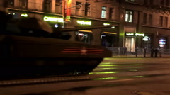 Night rehearsal of parade with the passing of military equipment on city streets - stock footage