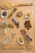 Brown spices on a brown background Stock Photos