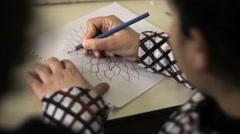 Iraqi Kurdistan girl drawing in classroom Stock Footage
