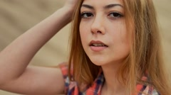 sexy young blonde woman she smiles in desert sand slow motion outdoors - stock footage