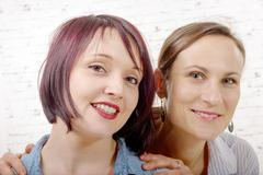 Portrait of a beautiful two young women smiling Stock Photos