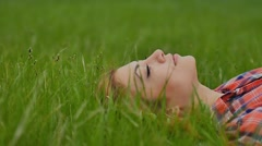 Girl sexy lying on green grass slow motion outdoors Stock Footage