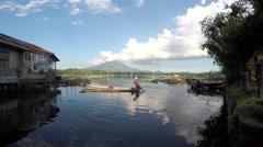 boatman maneuvers his boat on lake - stock footage