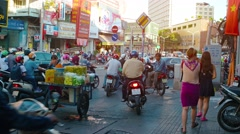 Motorcycles bypassing traffic on the sidewalk in Ho Chi Minh City, with sound Stock Footage