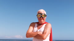 Fancy-dress mature man raising arm Stock Footage