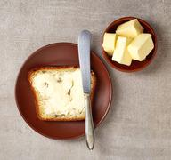 Sliced bread with butter - stock photo