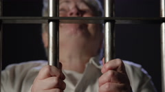 Hysterical Woman in Prison - Elderly trapped for crime - stock footage