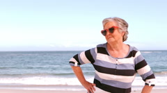 Mature woman raising arm Stock Footage