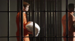 Modern Prison - People in Jail for Crimes - Prisoners carrying laundry - stock footage