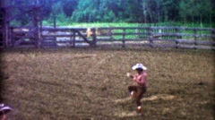 1955: Fancy rodeo cowboy lasso rope work jumping thru spinning hazard. Stock Footage