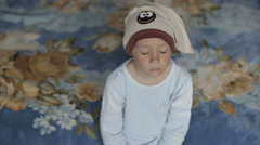 A boy fell asleep while sitting on the couch. - stock footage