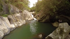 Happy tourist swims in peaceful pool at base of Ba Ho waterfall. Nha Trang Stock Footage