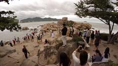 Tourists exploring the Hon Chong Rocks near Nha Trang. Stock Footage