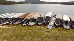 Many passenger tour boats beached in the mud in Dalat. Stock Footage