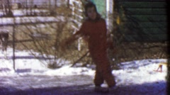 1954: Girl ice skating on backyard frozen water makeshift rink. Stock Footage