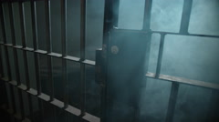 Creepy Haunted Prison Cell - Smoke and Mist through the bars Stock Footage