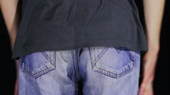 Man Turns the Empty Back Pockets of His Jeans. No Money - stock footage