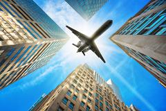 Airplane over new york Stock Photos