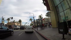 Timelapse of Driving by Hollywood Blvd at Highland Ave - stock footage